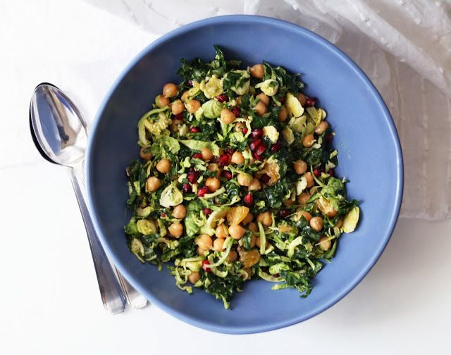 ... KALE AND BRUSSELS SPROUT SALAD WITH CHICKPEAS, CITRUS + POMEGRANATE