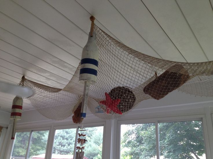 Fish net on ceiling merchandising idea pinterest for Fishing net decor ideas