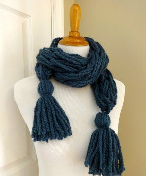 This simple arm knitting project features cute tassels and easy knots. Give it a try today!