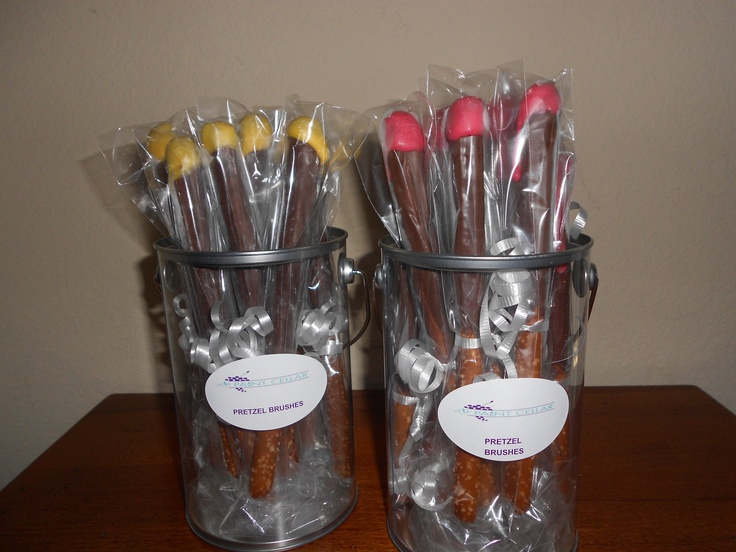Paint brush pretzel rods in paint cans matching label with companies