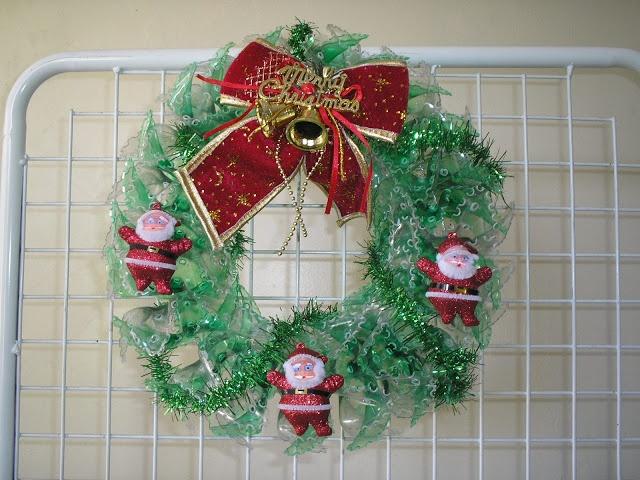 Plastic bottle wreath plastic pinterest for Christmas decor using plastic bottles