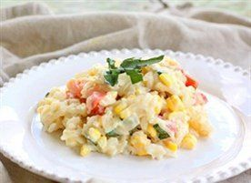 In this Tomato and Corn Risotto, creamy Parmesan risotto is sprinkled ...