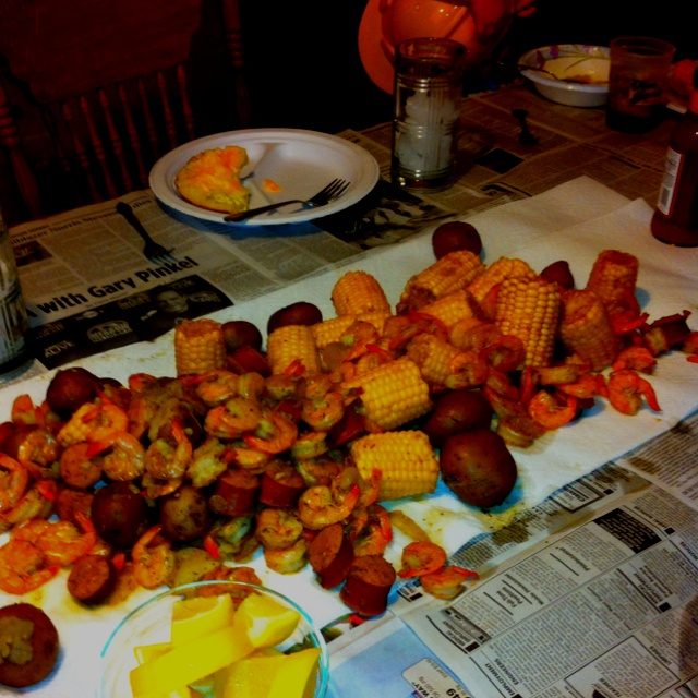 Seafood boil made with shrimp, polish sausage, onions, potatoes, corn ...
