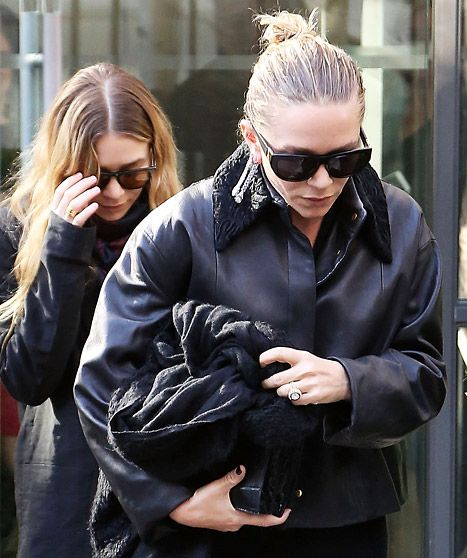 That rock is huge! Mary-Kate Olsen flashed her giant diamond engagement ring while attending the Louis Vuitton fall 2014 show in Paris.
