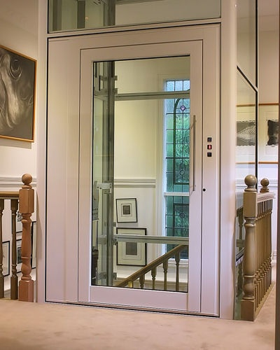 Glass elevator for handicap accessible home for Wheelchair accessible house plans with elevator