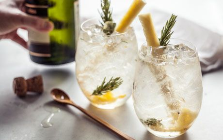 cocktail made with fresh pineapple, rosemary, sparking wine and ginger ...