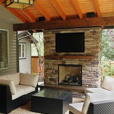 Covered Deck w fireplace Lawns and Gardens