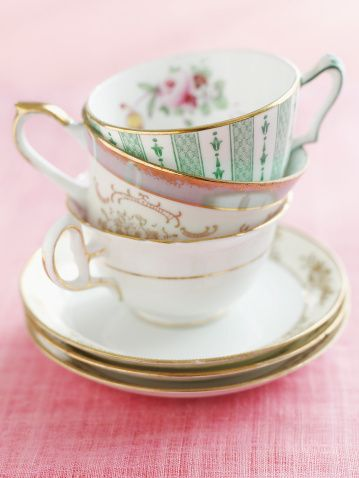 Small #centerpiece, stack vintage cups and plates.