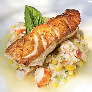 Roasted grouper with seafood risotto with champagne-citrus beurre blanc