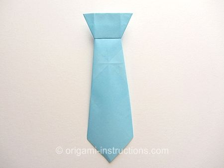 Origami tie made it out of a dollar bill to match the origami shirt