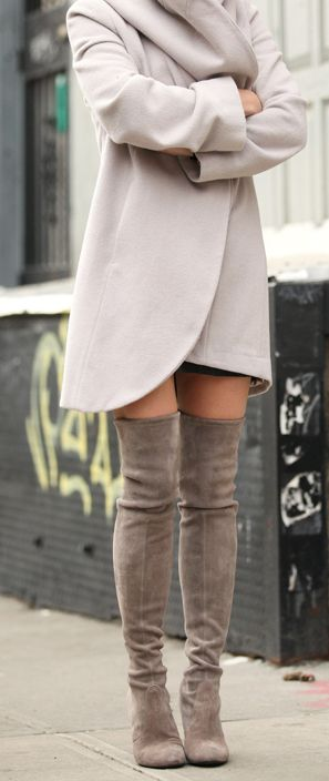 Camel coat and over the knee boots.