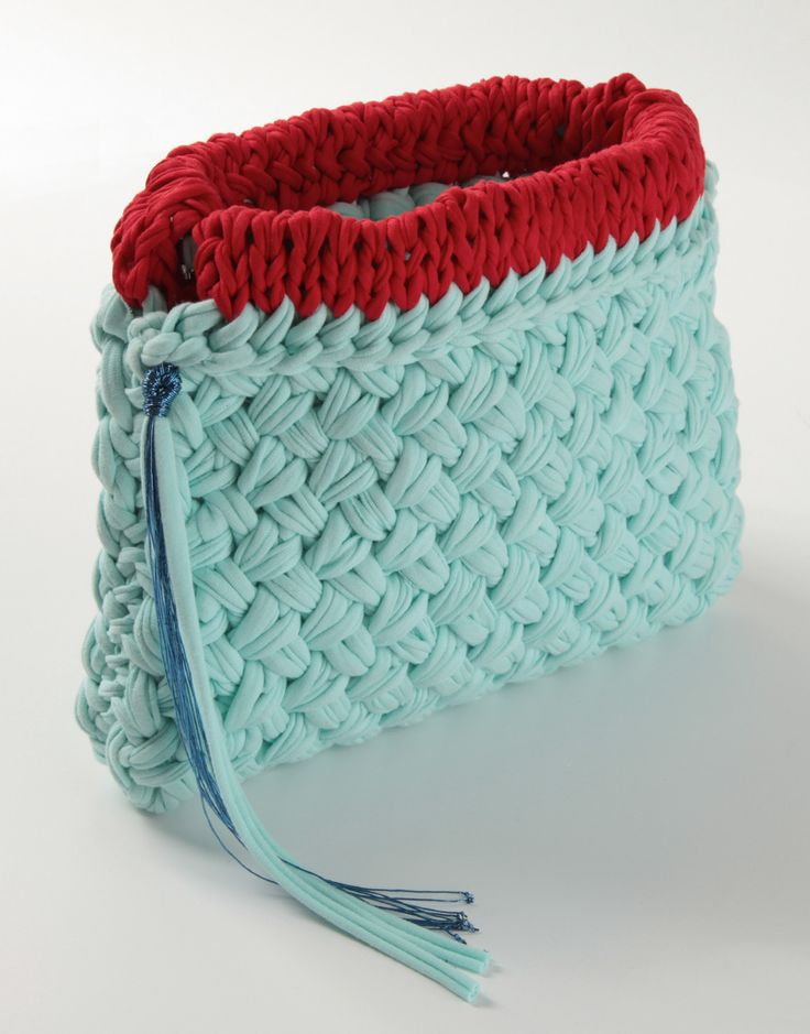 Crochet this cute and sturdy clutch with Lion Brands Fettuccini yarn.