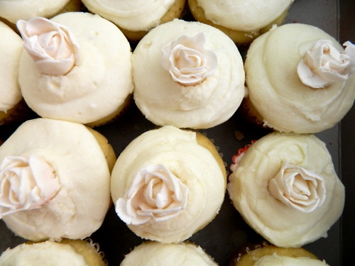 rum cupcakes filled with dulce de leche with vanilla frosting topped ...