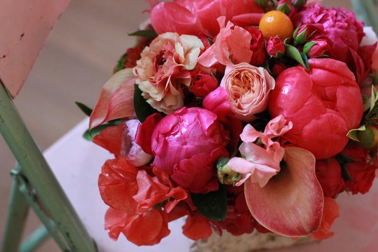 peonies peach garden roses kumquats ranunculus and sweet peas in a