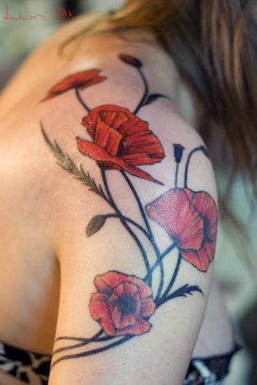 Gorgeous shoulder tattoo of red poppies skin ink for How to lighten a tattoo with white ink