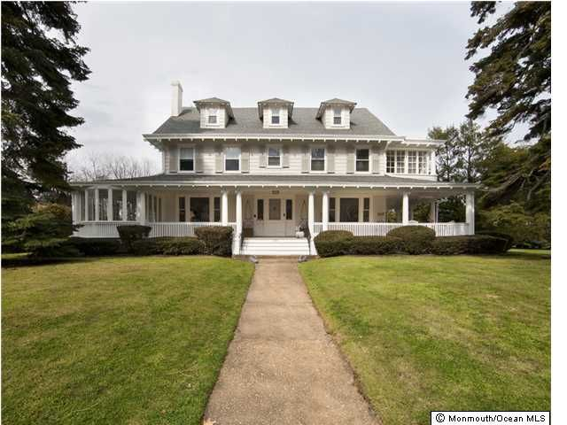 Colonial Revival with huge porch AND sunrooms (plural)!