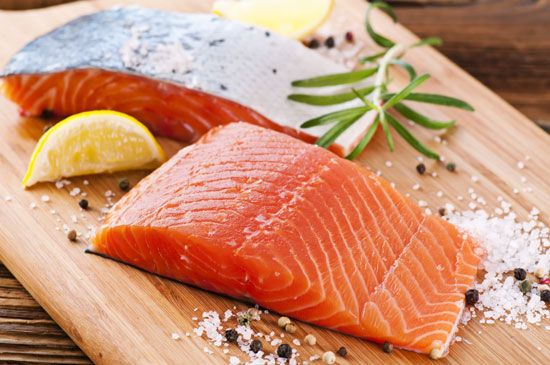 Grilled salmon, bundled in corn husks like a salt-and-pepper seasoned ...