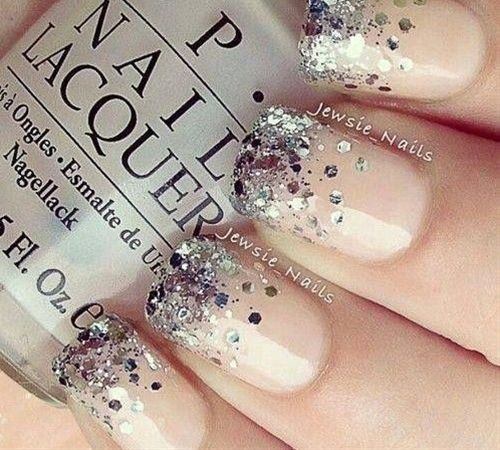 Beige nails with silver confetti glitter tips favorite!