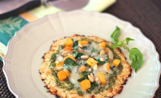 Spinach, butternut squash and pesto pizza on cauliflower crust