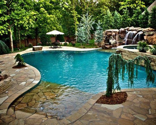Small Natural Backyard Pool : Natural boulder waterfalls, beach entry, glass tile inlaid spa