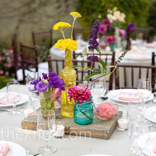 Vintage wedding colorful flower centerpieces photo by love ala los