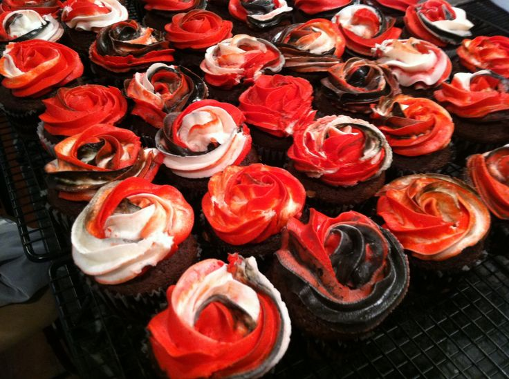 Chocolate filled chocolate cupcakes decorated in local HS colors.
