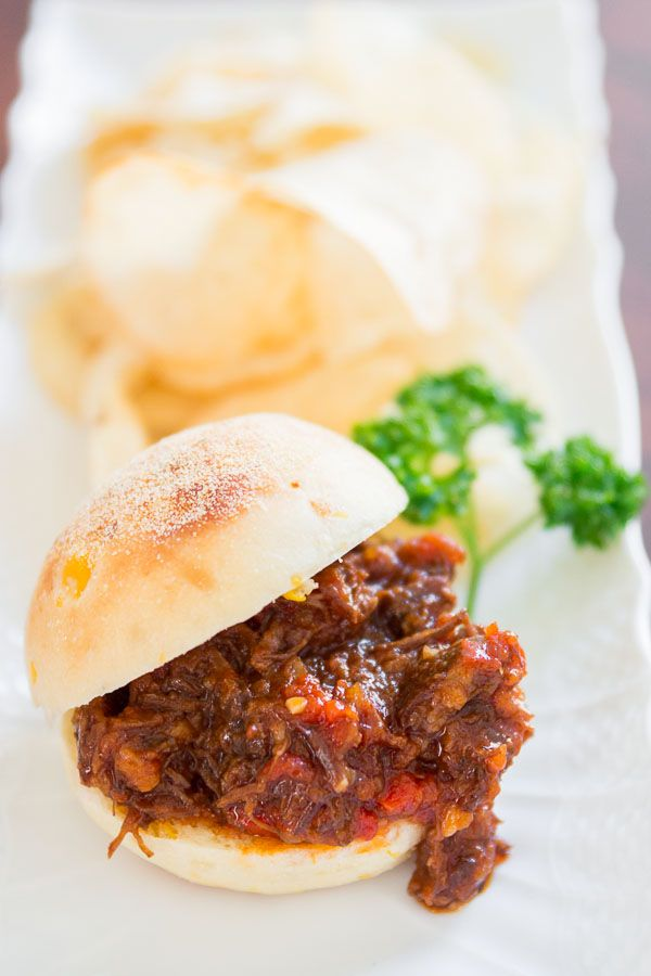 Sloppy Joes: with shredded beef simmered in a sweet tomato sauce ...