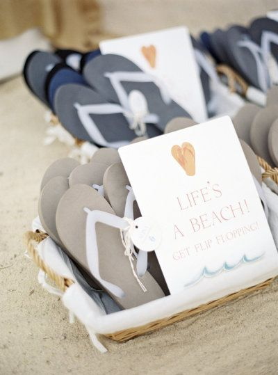 flip flops for guests at this seaside wedding Photography by Polly Alexandre / alexandreweddings.com, Event Design   Planning by http://www.foreverandeverevents.com/