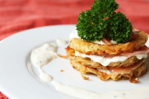 stacked potato rosti layered with smoked salmon and sour cream and ...