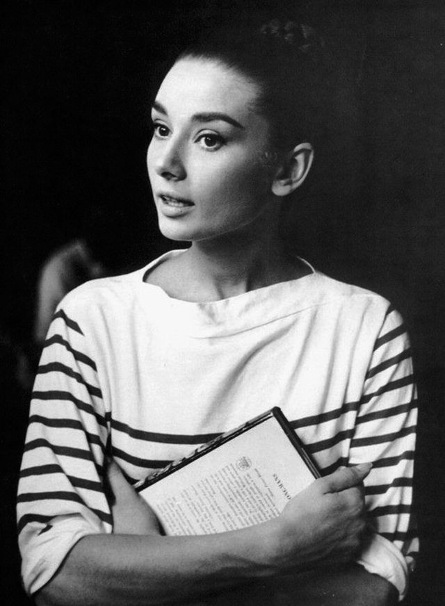 A photo of Audrey Hepburn on the set of War & Peace 1955, look as chic as ever in a Breton striped shirt.