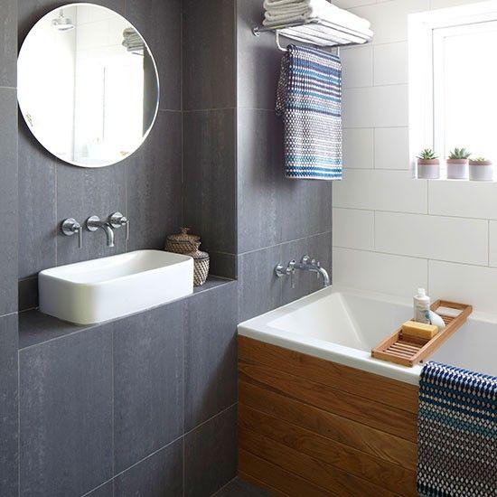 cuarto de bao moderno con los azulejos grises pizarra