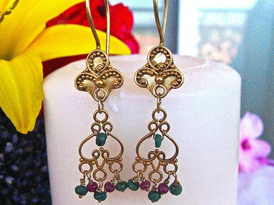 Designed & created by Debe for Debe's Gems. Bali style dangle earrings with Rubies & Emeralds hung on 24k gold Vermeil. For those who love 24k gold but can't afford it, these are the earrings for you!  The bonding on Sterling Silver makes the 24k gold stick longer & look more authentic & real.  In this economy Vermeil is a great option for an alternative to solid gold.  The beauty is, nobody but you will know it is not solid gold.  Starting price is $30.00 or buy it now for $36.00.