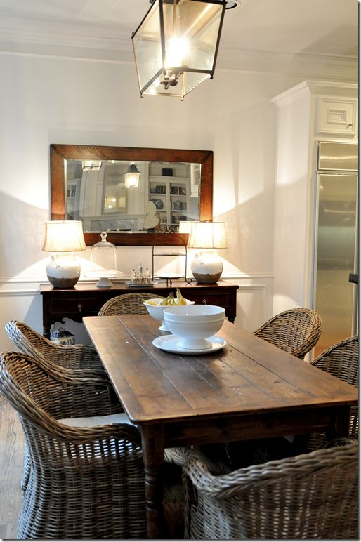Love the table, wicker chairs, and light fixture.