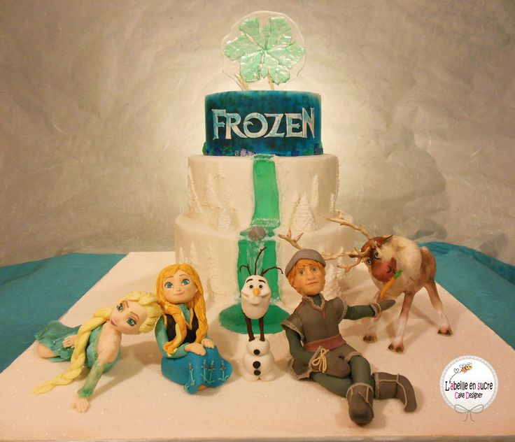 Cake inspired by the disney movie frozen with elsa anna olaf
