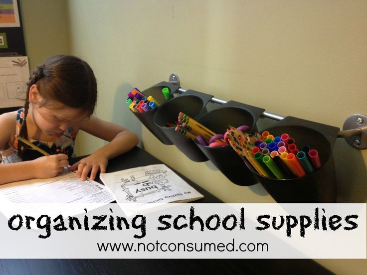 Organizing school supplies: pencils, crayons, glue, and scissors.