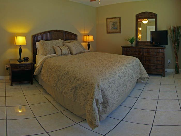 second bedroom features queen size bed and 26 tv