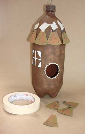 Made out of a two liter plastic pop bottles crafts for Plastic bottle bird house