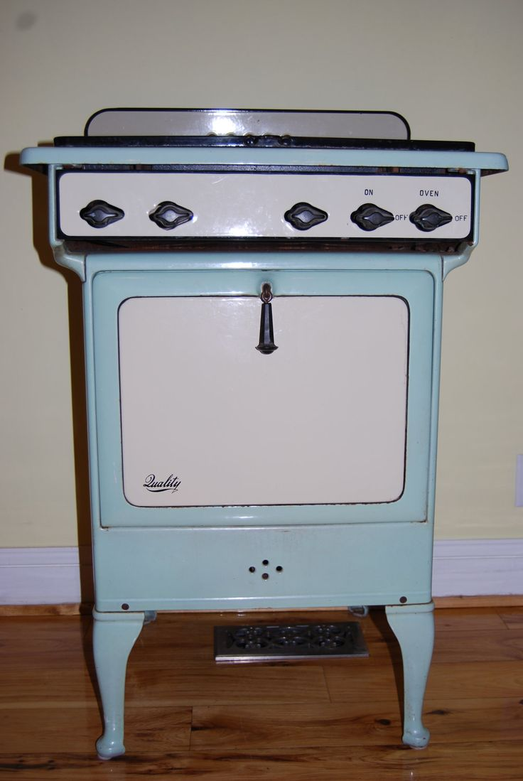 vintage enameled gas oven stove in mint green and creamy