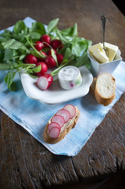 ... slices of fresh baguette, salted butter, thin slices of radishes and