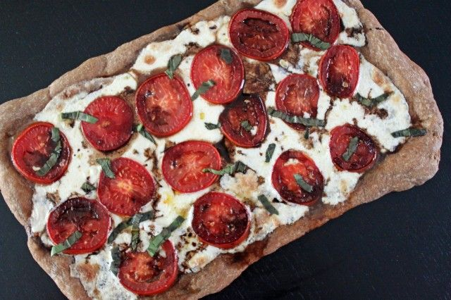 This pizza is pretty similar to a margarita pizza, but with the ever ...
