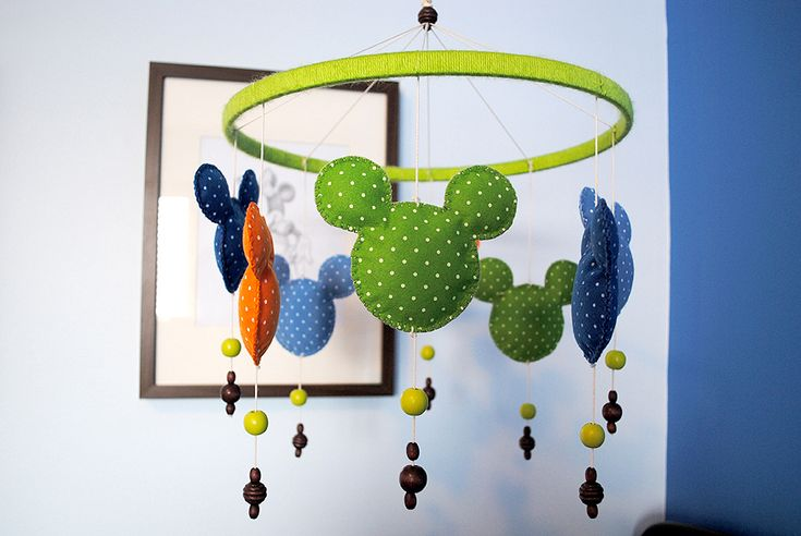 Mickey Mouse mobile - what a fun touch to a bright baby room!