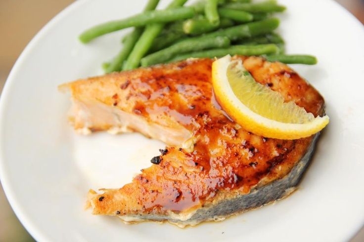 Salmon Steaks topped with butter, lemon juice, green onion, parsley, garlic and lemon-pepper seasoning. http://ow.ly/cgRqR #recipes #cooking