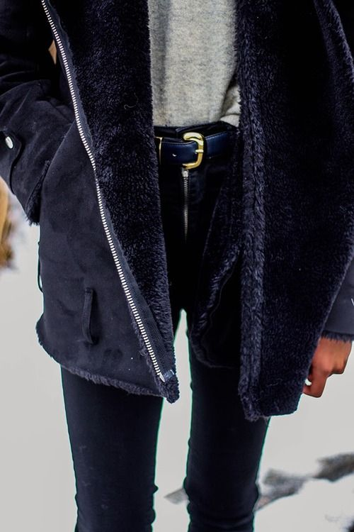 black sheepskin coat, high waisted black skinny jeans, casual tshirt.