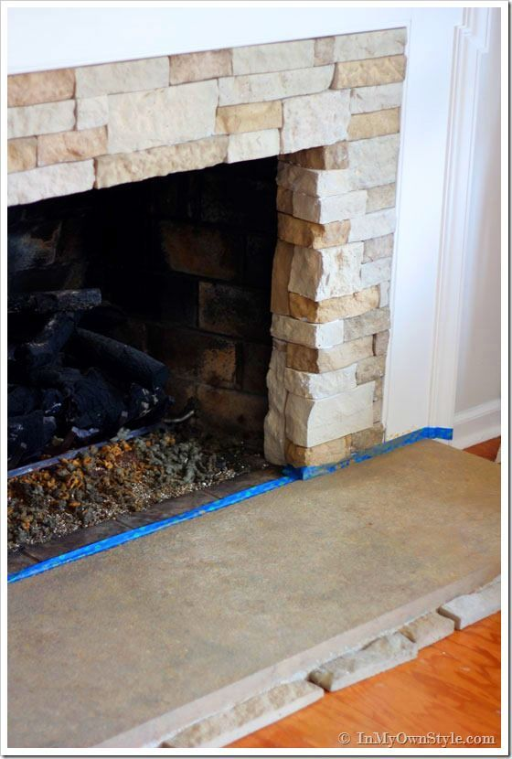 Stacked Stone Over Brick Fireplace 560 x 830