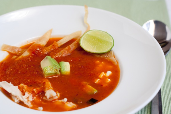 Sopa Azteca via Tasty Trix - Spicy, brothy, tomato-peppery goodness.