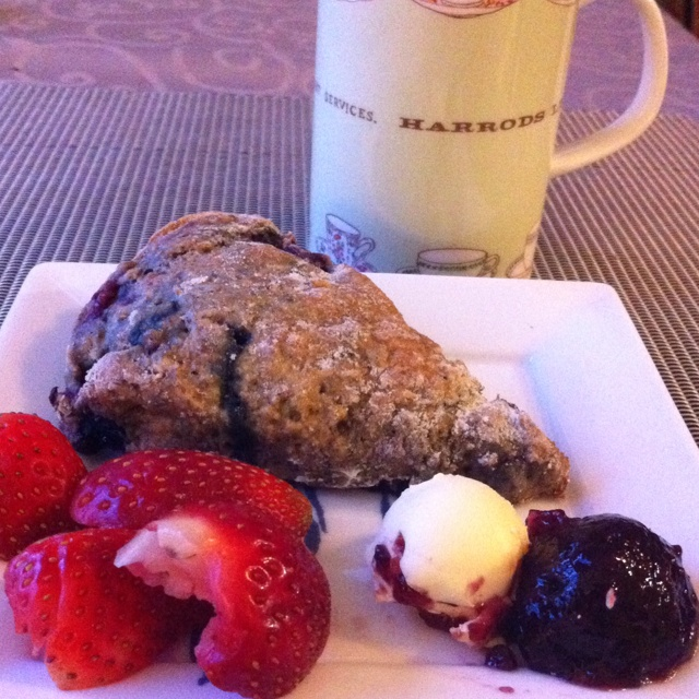 ... fruit scone, low fat spread and preserves, strawberries and black tea
