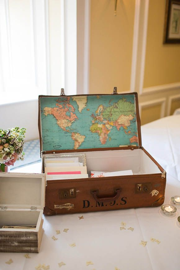 Vintage suitcase lined with vintage map to gather cards from wedding guests