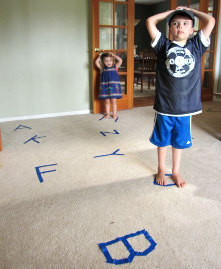 This gross motor activity would be good for learning letters. Have a bunch of letters taped on the floor, play some music and when the music stops, have the child ID the letter they are on