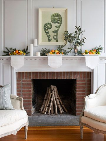 winter mantel: stacked birch logs + plates of citrus