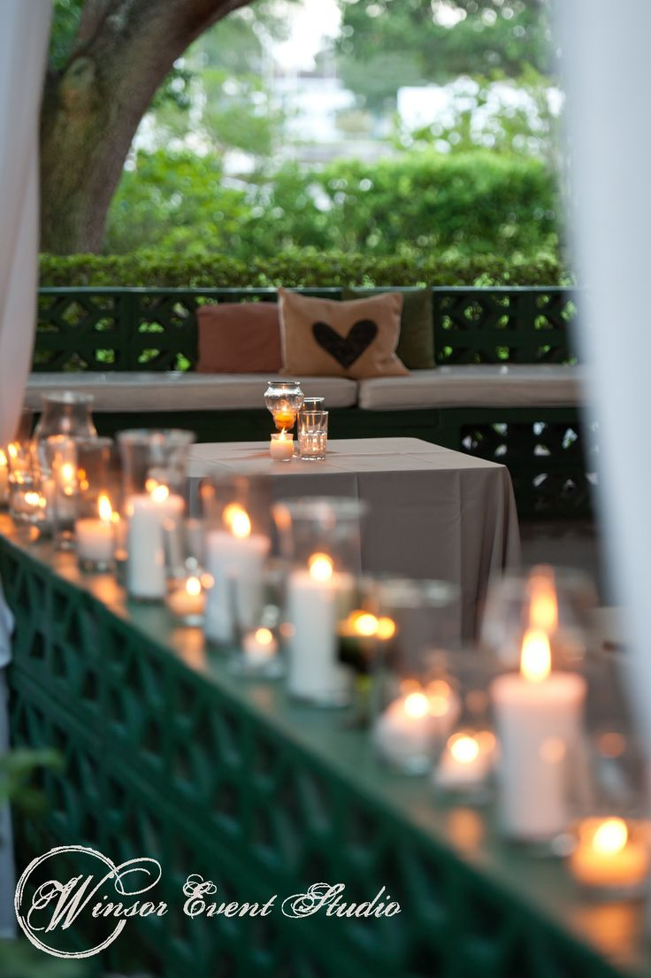 Various Candles Lining The Veranda Wall Of The Davis Islands Garden Club Lavender Mint